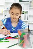 Young girl working on her school project at home. — Stock Photo