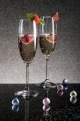 Two glasses of champagne with strawberries — Stock Photo