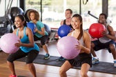 Gym class doing squats — Stock Photo