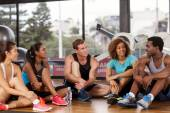 Group relaxing before a gym class — 图库照片