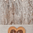 Wooden decorative heart on the lace fabric and old wood — Stock Photo #52096617
