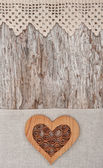 Wooden decorative heart on the lace fabric and old wood — Stok fotoğraf