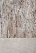 Linen fabric on the old rustic wood — Stock Photo