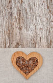 Wooden decorative heart on the linen fabric and old wood — Foto de Stock