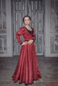 Beautiful woman in red medieval dress  — Stock Photo