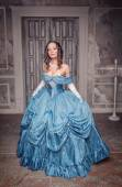 Beautiful medieval woman in long blue dress  — Foto de Stock
