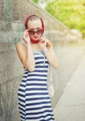 Young beautiful woman with sunglasses and shawl — Stockfoto