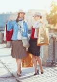 Two beautiful girls with shopping bags  — Stock Photo