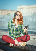 Hipster girl with headphones listening music — Stock Photo