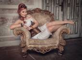 Beautiful steampunk woman on the armchair — Foto de Stock