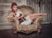 Beautiful steampunk woman on the armchair — Fotografia Stock