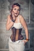 Beautiful steampunk woman surprised — Stock Photo