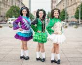 Three women in irish dance dresses posing  — Stock Photo
