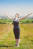 Smiling fitness plus size woman enjoy sunlight — Stock Photo