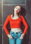 Young beautiful girl in red blouse enjoy sunlight  — Foto de Stock