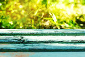 Empty rustic wooden table with abstract summer background — Stock Photo