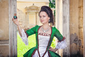 Beautiful woman in medieval dress with perfume bottle — Stock Photo