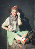Beautiful girl in vintage clothing with retro camera — Stok fotoğraf