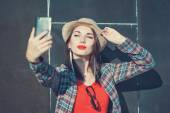 Beautiful girl taking picture of herself, selfie  — Photo