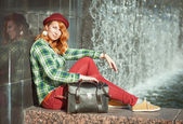 Hipster redhead girl in checkered shirt — Stockfoto