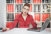 Tired business woman working with laptop — Stock Photo