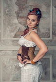 Beautiful steampunk woman with pink hair — Stock Photo