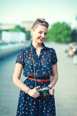 Beautiful young girl in fifties style with braces winking  — Foto de Stock