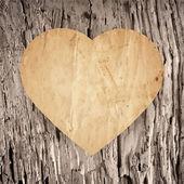 古い木材の背景の紙のハート — ストックベクタ