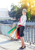 Happy beautiful girl with shopping bags in the city  — Stockfoto