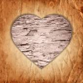 Wooden heart on the old paper background — Stock vektor