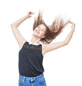 Happy young teenager girl with hands up and fluttering hair — Stock Photo
