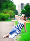 Young beautiful fashionable woman wearing striped dress  — Foto de Stock