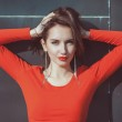 Young beautiful hipster girl in red blouse — Stock Photo #66006563