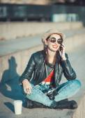 Hipster girl in leather jacket, hat with retro camera and mobile — Stock Photo