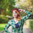Cheerful hipster redhead girl in hat with retro camera — Stock Photo #67328023