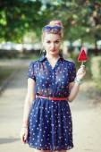 Beautiful young woman in fifties style with candy — Stock Photo