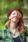 Hipster redhead woman making a moustache with her hair — Stock Photo