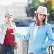 Young beautiful woman having quarrel with her friend in the city — Stock Photo #68673951