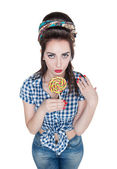 Young beautiful woman in retro pin-up style with lollipop — Stock Photo