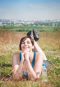 Beautiful plus size woman in sportswear lying on the meadow outd — Stock Photo