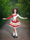 Young woman in irish dance dress and wig welcoming  — Photo