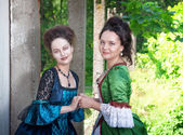 Two young beautiful women in long medieval dresses  — Stock Photo