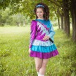 Young beautiful girl in irish dance dress posing outdoor — Stock Photo #72811647