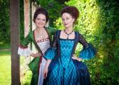 Two young beautiful women in medieval dresses outdoor — Foto de Stock