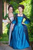 Two young beautiful women in medieval dresses outdoor — Stock Photo