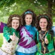 Three girls in irish dance dresses showing thumbs up — Stock Photo #73840751