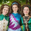 Three young beautiful girls in irish dance dress posing outdoor — Stock Photo #73840775