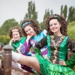Three young beautiful girls in irish dance dress and wig posing — Stock Photo #73840777
