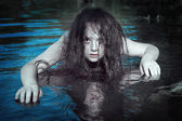 Young beautiful drowned ghost woman in the water  — Stock Photo