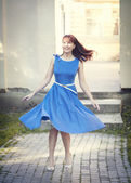 Beautiful woman in retro style dress whirl — Stock Photo
